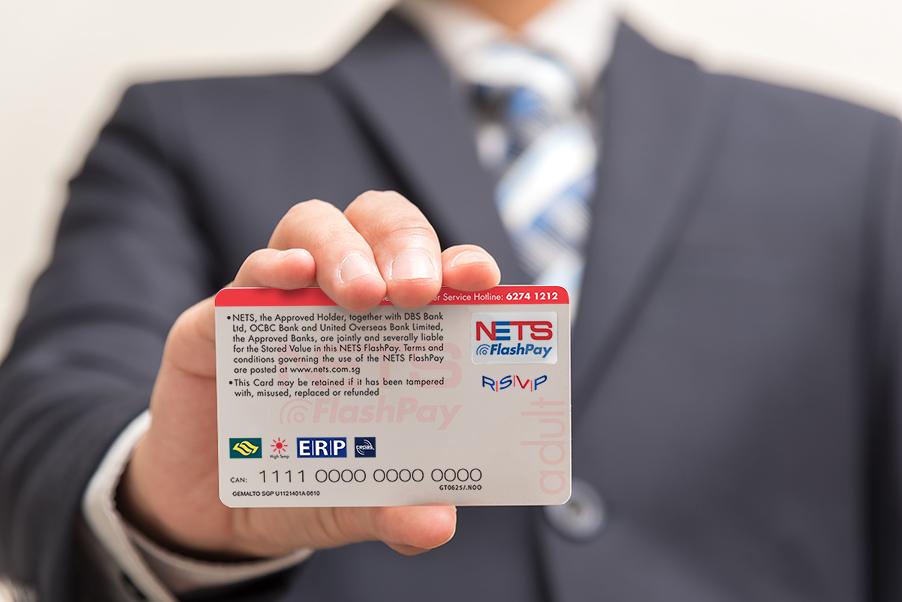 Man holding NETS Flashpay card